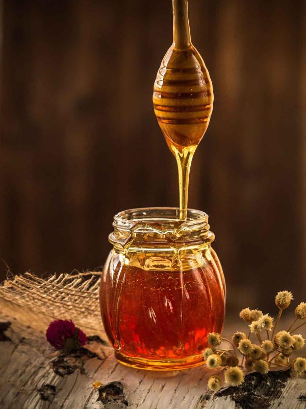 Honigglas Honigloeffel dunkel Bremer Gewuerzhandel